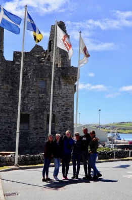 Crew with St Patrick;s castle behind, Shetland