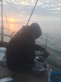 Peter Willis tidyng ropes at dawn, Irish Sea, Dublin bound Aug 5