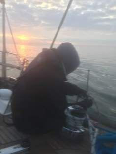 Peter Willis tidyng ropes at dawn, Irish Sea, Dublin bound Aug 5